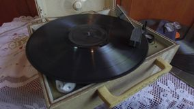 Vintage gramophone. Starting a vintage gramophone with a vinyl disk stock video
