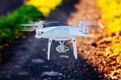 Starting white drone quadcopter Royalty Free Stock Photography