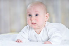 Startled baby Stock Images