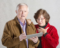 Startled Couple with Tablet Royalty Free Stock Photo