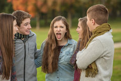 Startled Teens with Yelling Friend royalty free stock photo