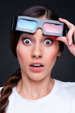 Startled woman in 3d glasses. Over dark background Stock Photography