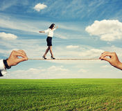 Startled woman balancing on the rope Stock Photo