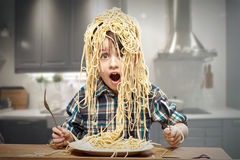 Startled yound boy with noodles Royalty Free Stock Image