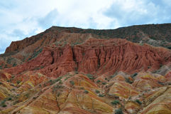 Startling Red canyons in Kyrgyz mountain Royalty Free Stock Images