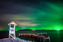 Startrail and aurora in Rayong,Thailand Royalty Free Stock Photo
