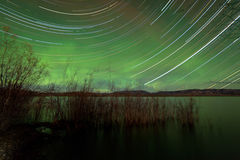 Startrails Aurora borealis display Lake Laberge Royalty Free Stock Image