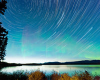 Startrails Aurora borealis display Lake Laberge Stock Images
