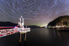 Startrails and fading northern lights Royalty Free Stock Photos