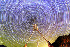 Startrails with interesting buildings pointing to the polaris in the center. British Columbia, Canada Royalty Free Stock Image