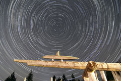 Startrails with interesting sculptures in the foreground Royalty Free Stock Image