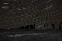 Startrails with orionid meteor. A long exposure shot, with startrails and a single orionid meteor stock images