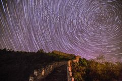 Startrails over the great wall Stock Photo
