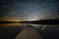 Startrails over the lake. Stock Photography