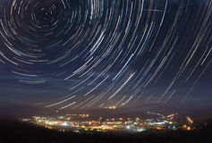 Startrails over the town Royalty Free Stock Photography