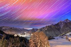 Startrails until sunrise in the Brandnertal. Beautiful stacked timelapse of stars at night until sunrise over the Brandnertal in the mountains of the Alps in royalty free stock photo