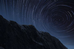 Startrails in a winter mountain area Stock Image