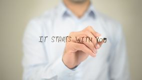It Starts with You, Man writing on transparent screen stock photography