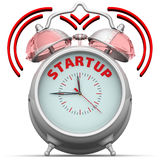 Startup. The alarm clock with an inscription. Alarm clock with the red words `STARTUP`. 3D Illustration. Isolated Stock Image