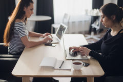 Free Startup Business Concept With Two Young Girls In Modern Bright Office Interior Working On Laptops And Tablet Computers Royalty Free Stock Photo - 94480605