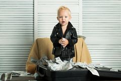 Startup business costs. Boy child with money case. Little entrepreneur work in office. Little boy count money in cash. Small child do business accounting in stock photos