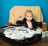 Startup business costs. Little entrepreneur work in office. Boy child with money case. Little boy count money in cash. Small child do business accounting in royalty free stock photography