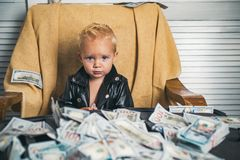 Startup business costs. Small child do business accounting in startup company. Boy child with money case. Little boy. Count money in cash. Little entrepreneur royalty free stock photo
