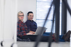 Startup business, couple working on laptop computer at office Stock Images