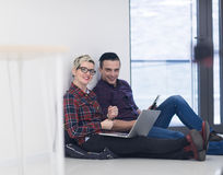 Startup business, couple working on laptop computer at office Stock Image