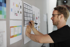 Startup Business People Looking on Strategy Board Information Th Stock Image