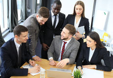 Startup business team on meeting in modern bright office interior and working on laptop. Royalty Free Stock Photos