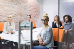 Startup Business Team At A Meeting at modern night office buildi Royalty Free Stock Photo
