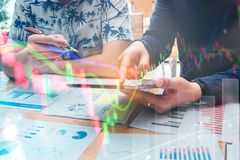 Startup business team meeting and working on digital tablet Stock market exchange information and Trading graph.  royalty free stock photo