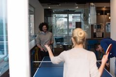 Startup business team playing ping pong tennis Stock Photography