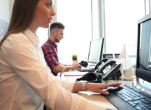 Startup business, two handsame businessmen working on computer at modern office. Royalty Free Stock Photo