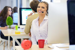 Startup business, young beautiful woman with braces as software developer working on computer Royalty Free Stock Photo