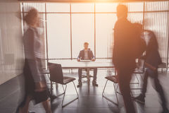 Startup business, young creative people group entering meeting room, motion blur, one man focused stock photos