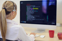 Startup business, young woman as software developer working on computer at modern office.  stock photography