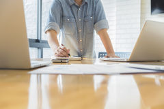 Startup businessman analyze the marketing charts and graphs on desk. Royalty Free Stock Images