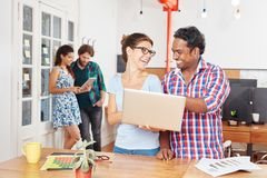 Startup colleagues fun teamwork. In coworking office Stock Photography