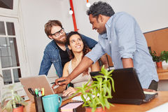 Startup computer training coach. With students royalty free stock photo
