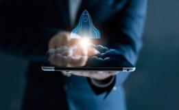 Startup concept, transparent rocket flying out of tablet screen. Startup concept, transparent rocket is launching and flying out of tablet on screen Stock Images