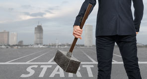 Startup. Determined businessman with hammer Stock Photography
