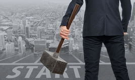 Startup. Determined businessman with hammer Stock Photos