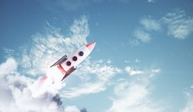 Startup and entrepreneurship concept. Creative launching rocket on bright blue sky with clouds background. Startup and entrepreneurship concept. 3D Rendering vector illustration
