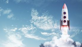 Startup and exploration concept. Creative launching rocket on bright blue sky with clouds background. Startup and exploration concept. 3D Rendering royalty free stock photography