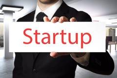 Startup hållande tecken för affärsman Fotografering för Bildbyråer