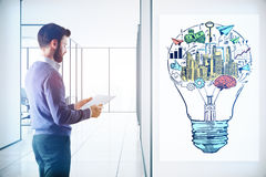 Startup ideas concept. Young businessman examining document in light interior with business lamp on banner. Start up ideas concept. 3D Rendering Stock Photos