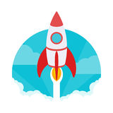 Startup illustration. The rocket takes off against Stock Photos