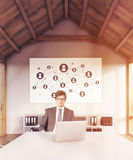 Startup leader at his workplace. Businessman in suit and glasses sitting in his office with laptop. Startup sketch on wall behind him. Concept of CEO. 3d Royalty Free Stock Images